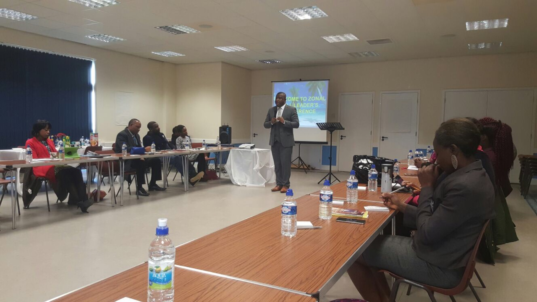 Leaders listen attentively as Pastor
